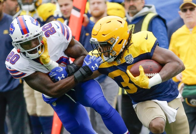 Buffalo Bills' Rafael Bush stops Green Bay Packers' Aaron Jones during the first half.