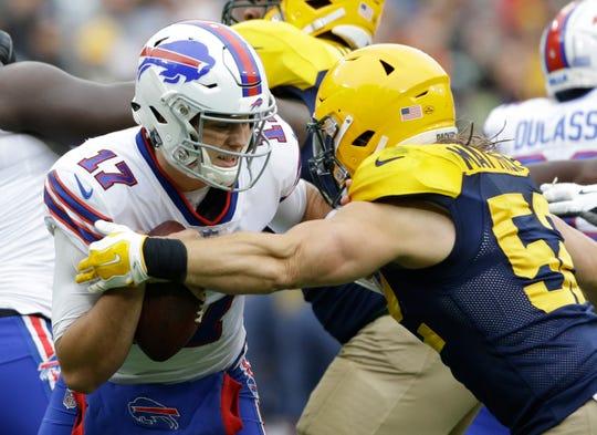 Green Bay Packers' Clay Matthews sacks Buffalo Bills' Josh Allen.