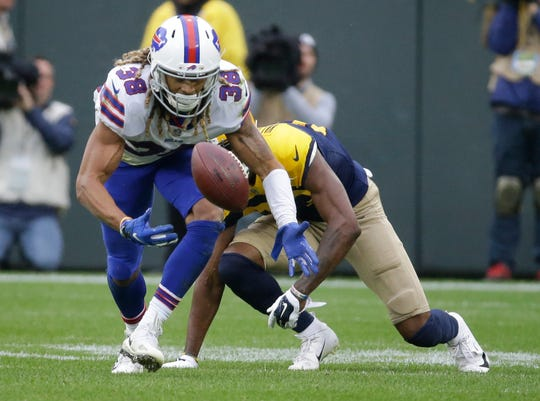 Buffalo Bills' Ryan Lewis breaks up a pass intended for Green Bay Packers' Marquez Valdes-Scantling.