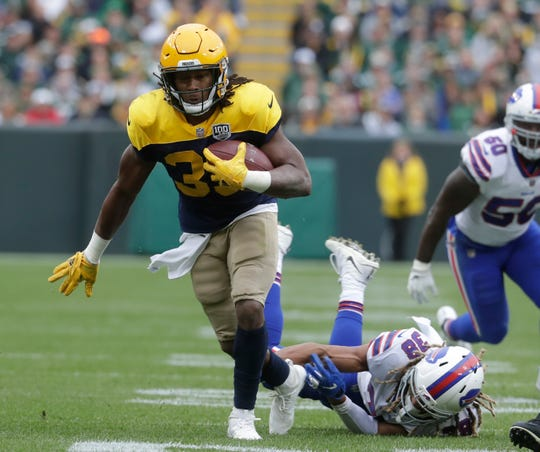 Green Bay Packers' Aaron Jones runs for a first down.