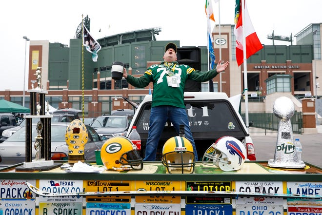 A fan tailgates before an NFL football game between the Green Bay Packers and the Buffalo Bills.