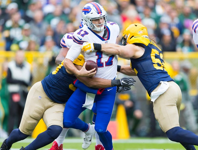 Buffalo Bills quarterback Josh Allen is sacked by Green Bay Packers linebacker Nick Perry  and linebacker Clay Matthews (during the second quarter at Lambeau Field.