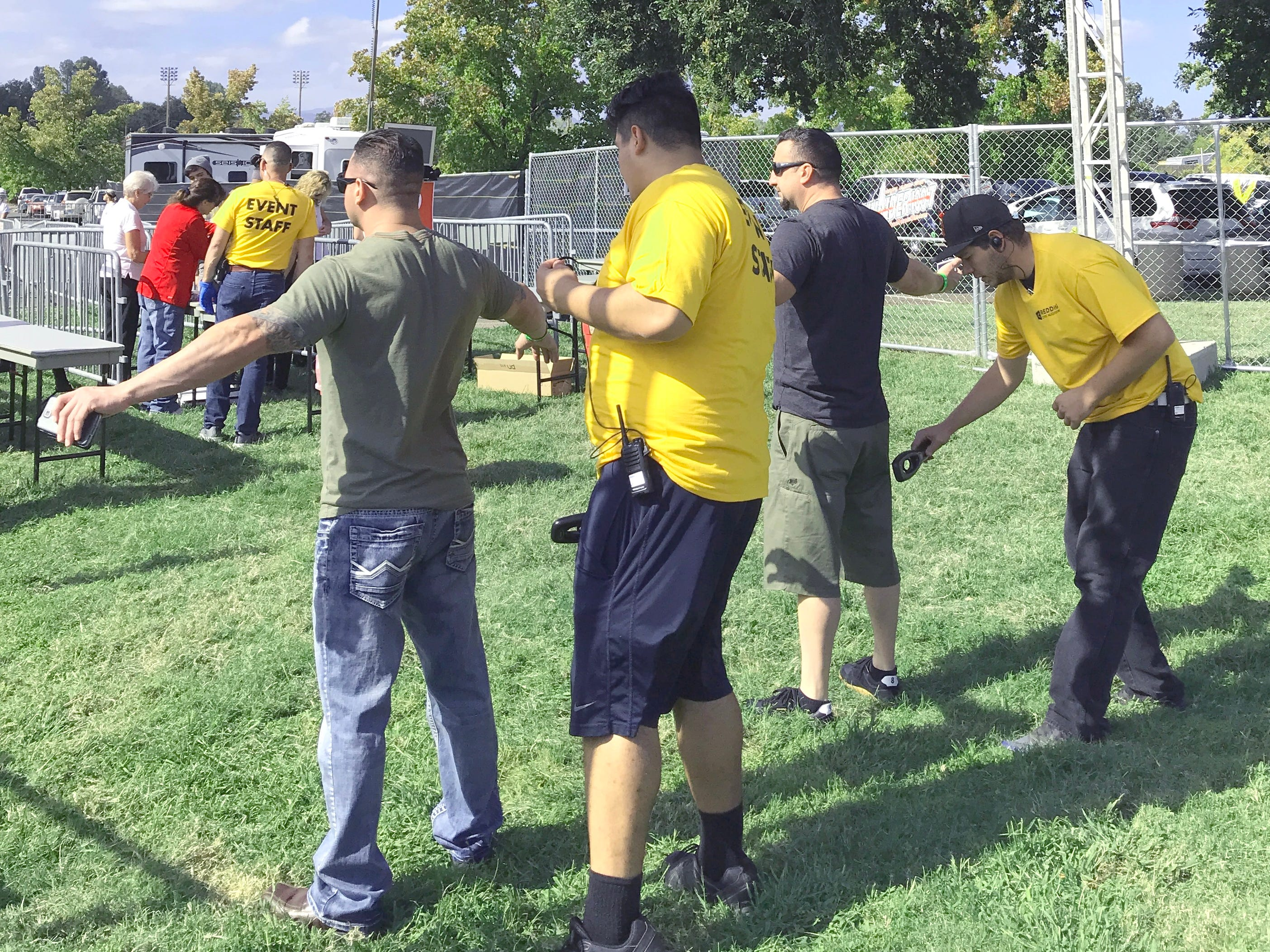 Festival-goers get the OK from security Saturday at the Redd Sun fest at the Redding Civic Auditorium.