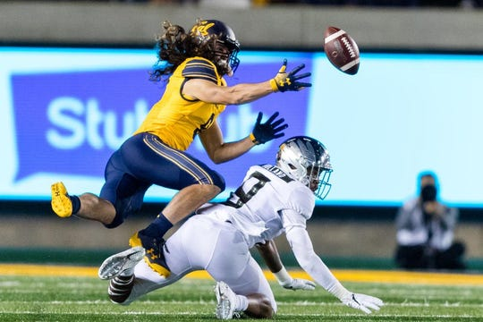 Oregon Ducks safety Jevon Holland (8) breaks up a pass to California Golden Bears wide receiver Kanawai Noa (9) in the second quarter at California Memorial Stadium on Saturday.