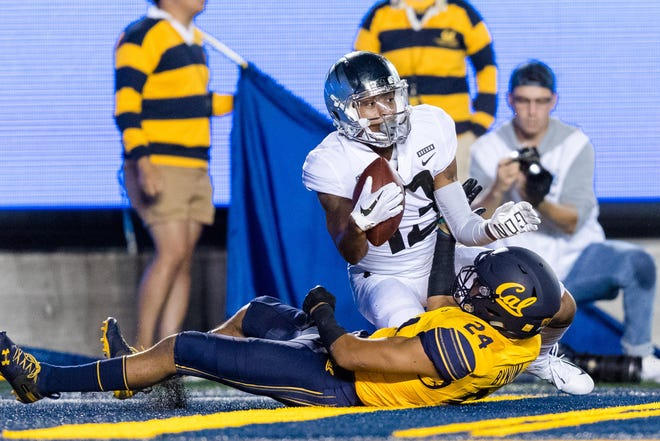 Sep 29, 2018; Berkeley, CA, USA; Oregon Ducks wide receiver Dillon Mitchell (13) reacts after scoring a touchdown as California Golden Bears cornerback Camryn Bynum (24) lies on the ground in the second quarter at California Memorial Stadium. Mandatory Credit: John Hefti-USA TODAY Sports
