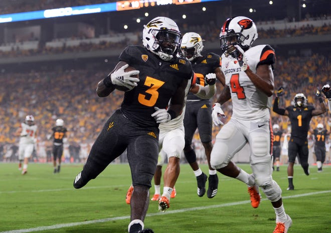 Sep 29, 2018; Tempe, AZ, USA; Arizona State Sun Devils running back Eno Benjamin (3) scores a touchdown against the Oregon State Beavers during the first half at Sun Devil Stadium. Mandatory Credit: Joe Camporeale-USA TODAY Sports