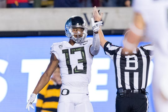 Oregon Ducks wide receiver Dillon Mitchell (13) reacts after scoring a touchdown against the California Golden Bears in the second quarter at California Memorial Stadium on Saturday.