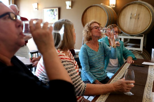 Friends, from left, Betsy Baldwin, Lois McIntosh, Beth Waterman-Hukari, all of Vancouver, Wash., and her mother, Marion Waterman, of Beaverton, go wine-tasting at Hanson Vineyards outside Woodburn, May 28, 2016.