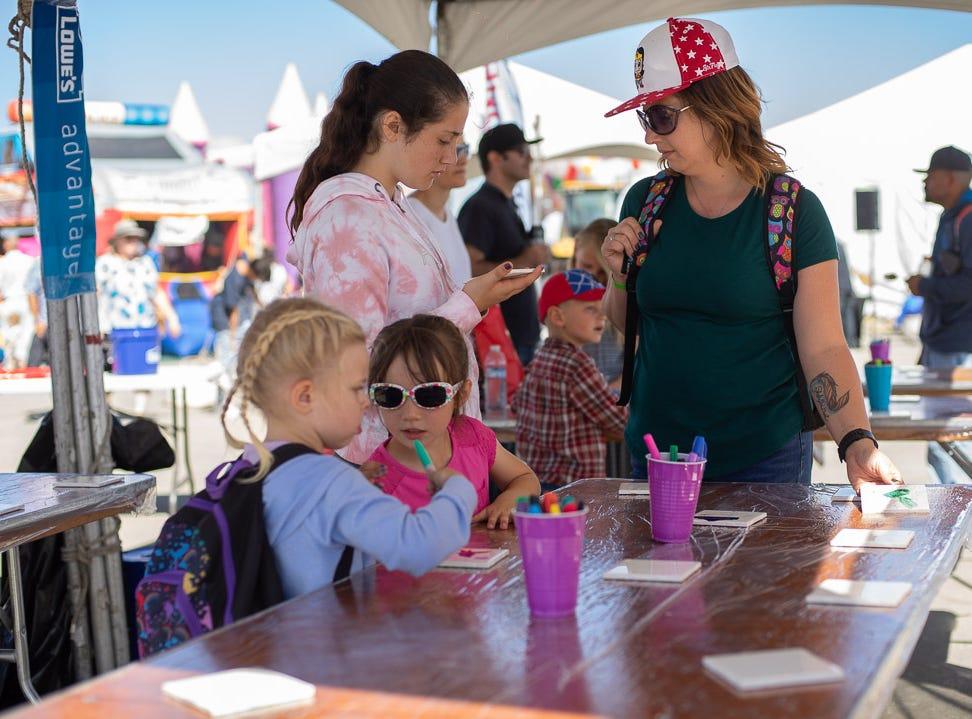 Children drawing at the Carls Jr Kids Zone during the California International Airshow Salinas at the Salinas Municipal Aiport on Saturday, September 29, 2018.