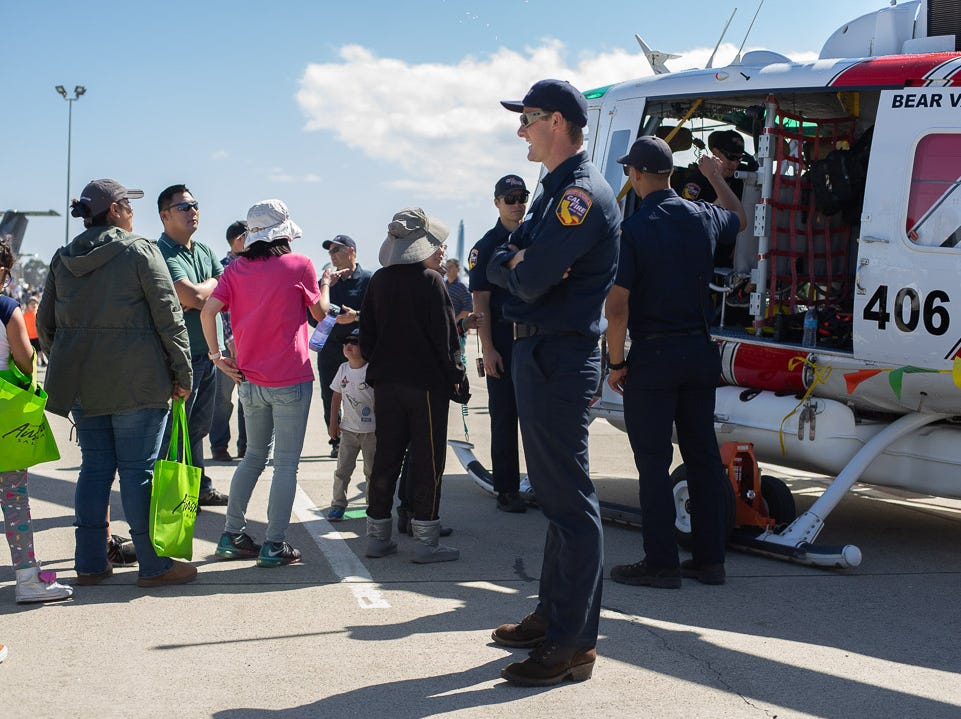 Cal Fire member talking to the attendees during the California International Airshow Salinas at the Salinas Municipal Airport on Saturday, September 29, 2018