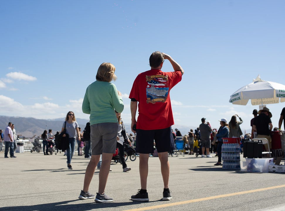 Spectators looking at the bright sky for the Jess Rodriguez Sky Diving during California International Airshow Salinas at the Salinas Municipal Airport on Saturday, September 29, 2018.
