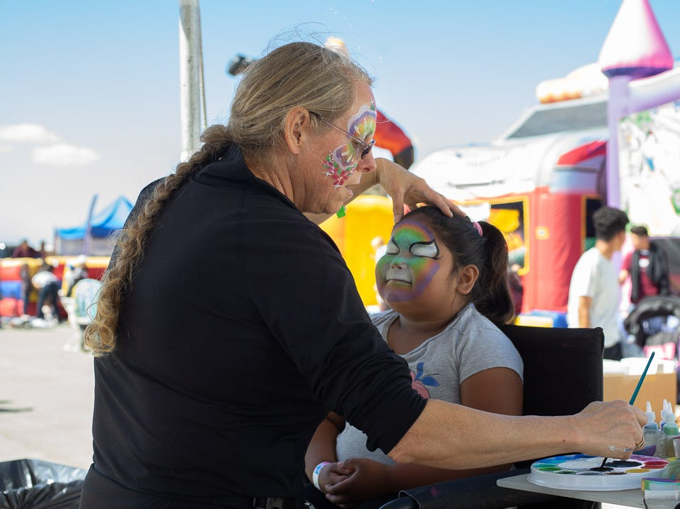Face painting during the California International Airshow Salinas at the Salinas Municipal Airport on Saturday, September 29, 2018.