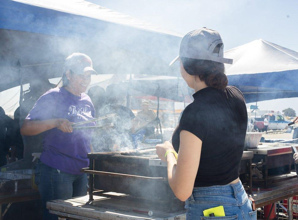 Salinas High Students grilling burger patties during the California International Airshow Salinas at the Salinas Municipal Airport on Saturday, September 29, 2018.
