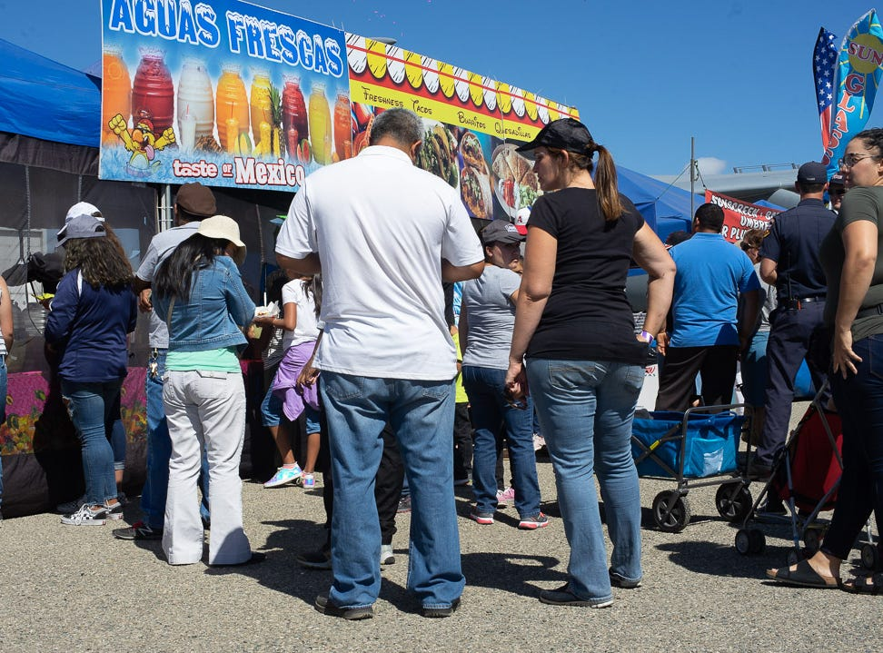 People form a line at the concession stands during the California International Airshow Salinas at the Salinas Municipal Aiport on Saturday, September 29, 2018.