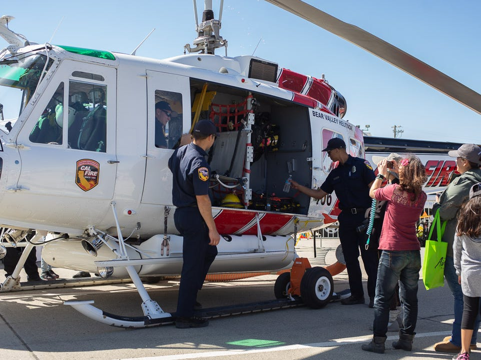 Cal Fire members showing a tour of the helicopter during the California International Airshow Salinas at the Salinas Municipal Airport on Saturday, September 29, 2018.
