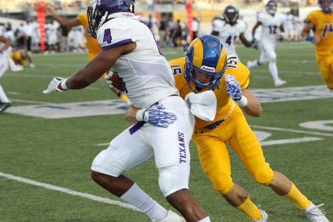 Angelo State University's Grant Emmons, a former Menard High School standout, tries to bring down Tarleton State wide receiver Zimari Manning during a Lone Star Conference football game at LeGrand Stadium at 1st Community Credit Union Field on Saturday, Sept. 29, 2018.
