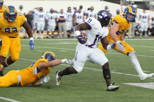 Tarleton State's  Adam Berryman picks up yardage during a Lone Star Conference football game against Angelo State at LeGrand Stadium at 1st Community Credit Union Field on Saturday, Sept. 29, 2018.  No. 25 Tarleton rolled to a 54-33 win.