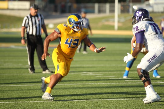 Angelo State University senior defensive end Markus Jones (43) looks to get past Tarleton State lineman Deon  Sheppard during a Lone Star Conference football game at LeGrand Stadium at 1st Community Credit Union Field on Saturday, Sept. 29, 2018.