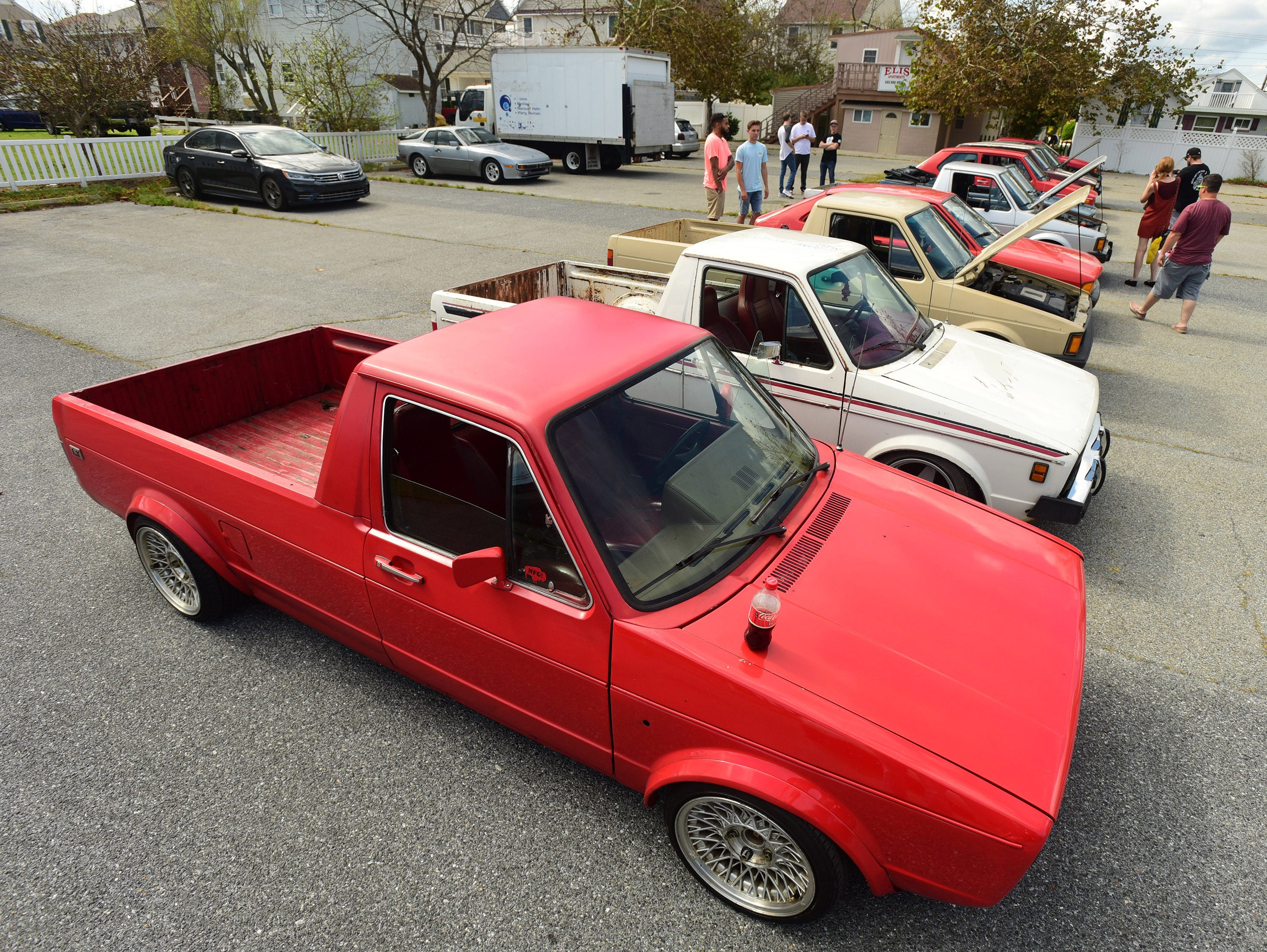 Spectators look at lowered VW pickups at the unofficial H2Oi event in the Pickles Pub parking lot. The event was moved officially to Atlantic City, but continued for many people in Ocean City on Saturday, Sept. 29, 2018.