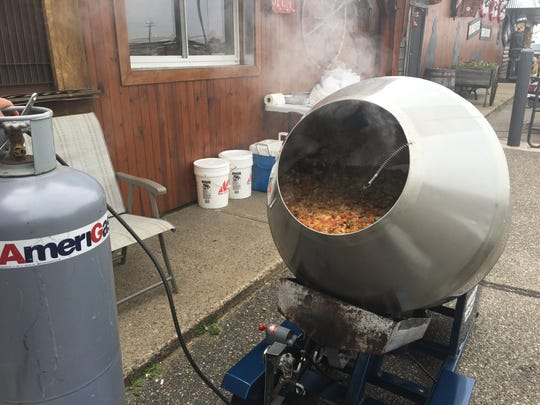 A 55-gallon mixer stirs up homemade booyah for the Tinville Lions fundraiser Sunday.