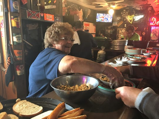 Joan Weyer dishes up crackers and bread for bowls of booyah for the Sunday Tinville Lions fundraiser at Rollie's.