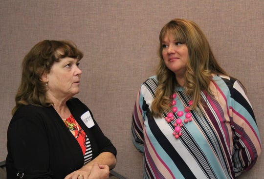 Maureen Einfeldt, board secretary, chats with Board Member Linda Hudson during the Canyon Creek Services annual board luncheon.