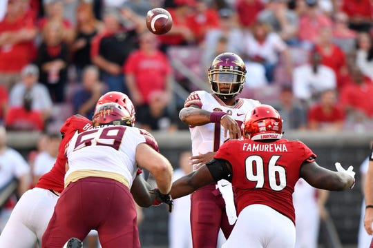 Florida State Seminoles quarterback Deondre Francois (12) throws the ball past Louisville Cardinals defensive lineman Henry Famurewa (96) during second half at Cardinal Stadium. Florida State defeated Louisville 28-24.