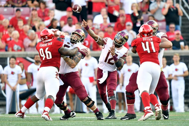 Florida State Seminoles quarterback Deondre Francois (12) throws a pass against the Louisville Cardinals during second half at Cardinal Stadium. Florida State defeated Louisville 28-24.
