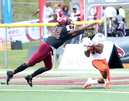 FAMU wide receiver Marcus Williams catches a touchdown pass over N.C. Central defensive back Anthony Sherrill.