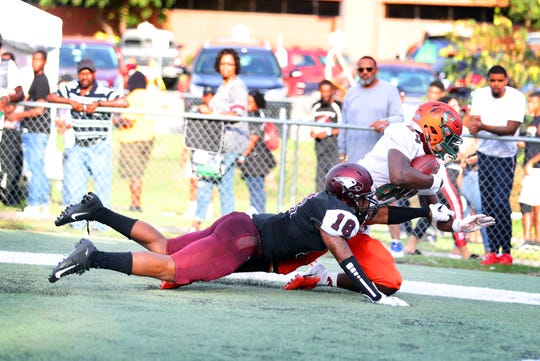 FAMU wide receiver Chad Hunter makes a grab over N.C. Central defensive back Marcus Martin.