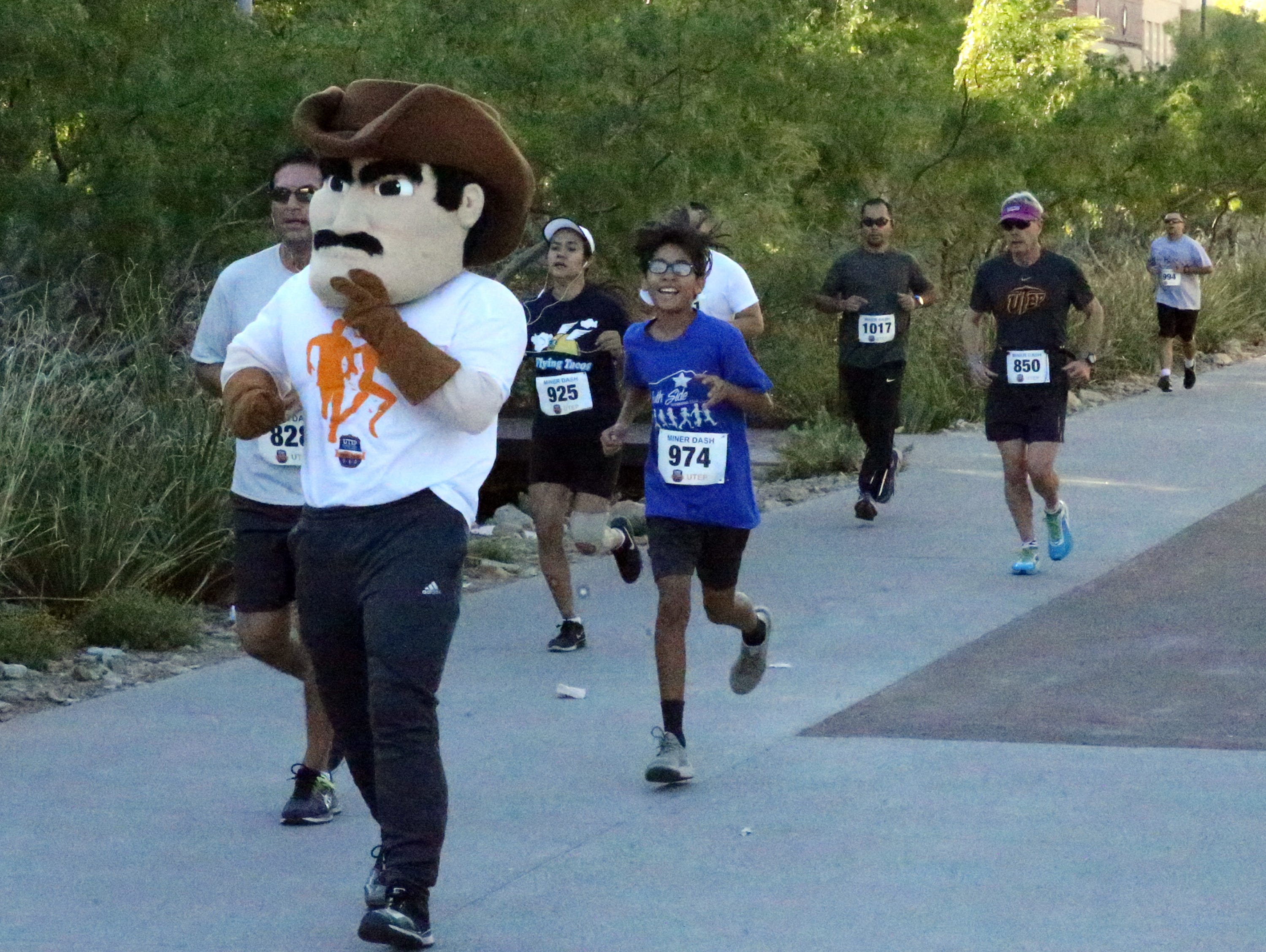 Paydirt Pete runs along the UTEP campus during the 9th annual Miner Dash Sunday.