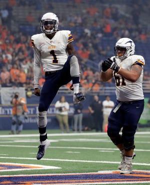 UTEP quarterback Kai Locksley (1) celebrates his touchdown during the first half of an NCAA college football game against UTSA on Saturday, Sept. 29, 2018, in San Antonio.