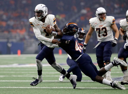 UTEP quarterback Kai Locksley (1) is pulled down by UTSA defensive end DeQuarius Henry (45) during the first half of an NCAA college football game Saturday, Sept. 29, 2018, in San Antonio. (AP Photo/Eric Gay)