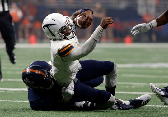 UTEP quarterback Kai Locksley, right, is stopped by UTSA defensive end DeQuarius Henry (45) on a run during the first half of an NCAA college football game, Saturday, Sept. 29, 2018, in San Antonio. (AP Photo/Eric Gay)