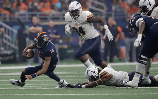 UTSA quarterback Cordale Grundy (14) runs against UTEP during the first half of an NCAA college football game, Saturday, Sept. 29, 2018, in San Antonio. (AP Photo/Eric Gay)