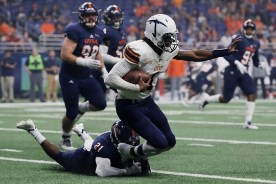 UTEP quarterback Kai Locksley (1) is sacked for a loss by UTSA safety Brenndan Johnson (21) during the first half of an NCAA college football game Saturday, Sept. 29, 2018, in San Antonio. (AP Photo/Eric Gay)
