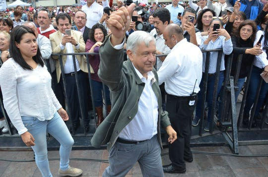 Mexico's President-elect Andres Manuel Lopez Obrador arrives to a Saturday rally commemorating the 50th anniversary of a bloody reprisal against students, at the Tlatelolco Plaza in Mexico City.  (AP Photo/Christian Palma)