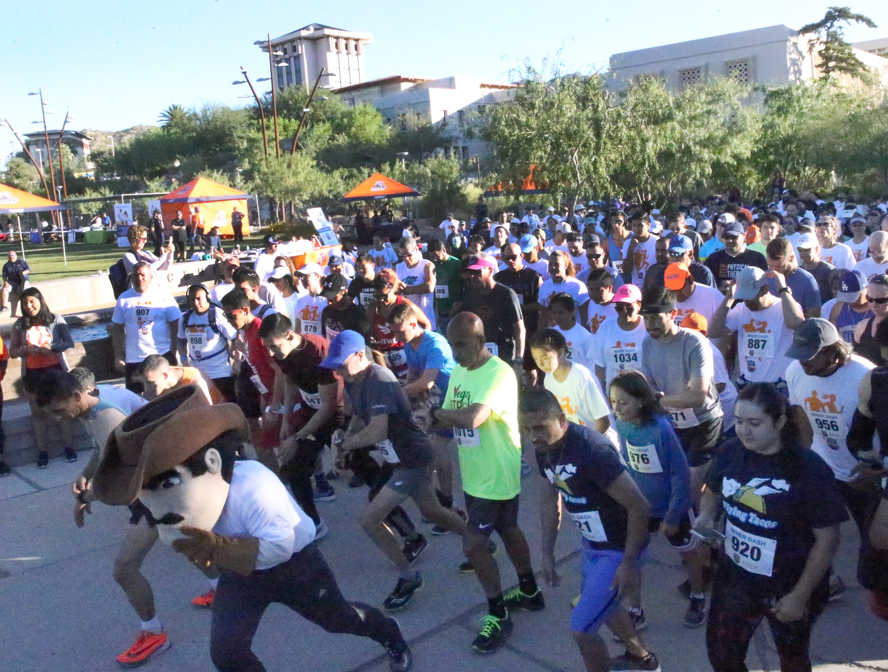 Paydirt leads the way at the start of the 9th Annual Miner Dash & Family Fiesta Sunday at Centennial Plaza on the UTEP campus.