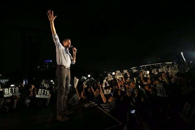 U.S. Rep. Beto O'Rourke takes the stage in front of nearly 60,000 people at Auditorium Shores in Austin, Texas. The rally also featured country music legend Willie Nelson and musician Leon Bridges.