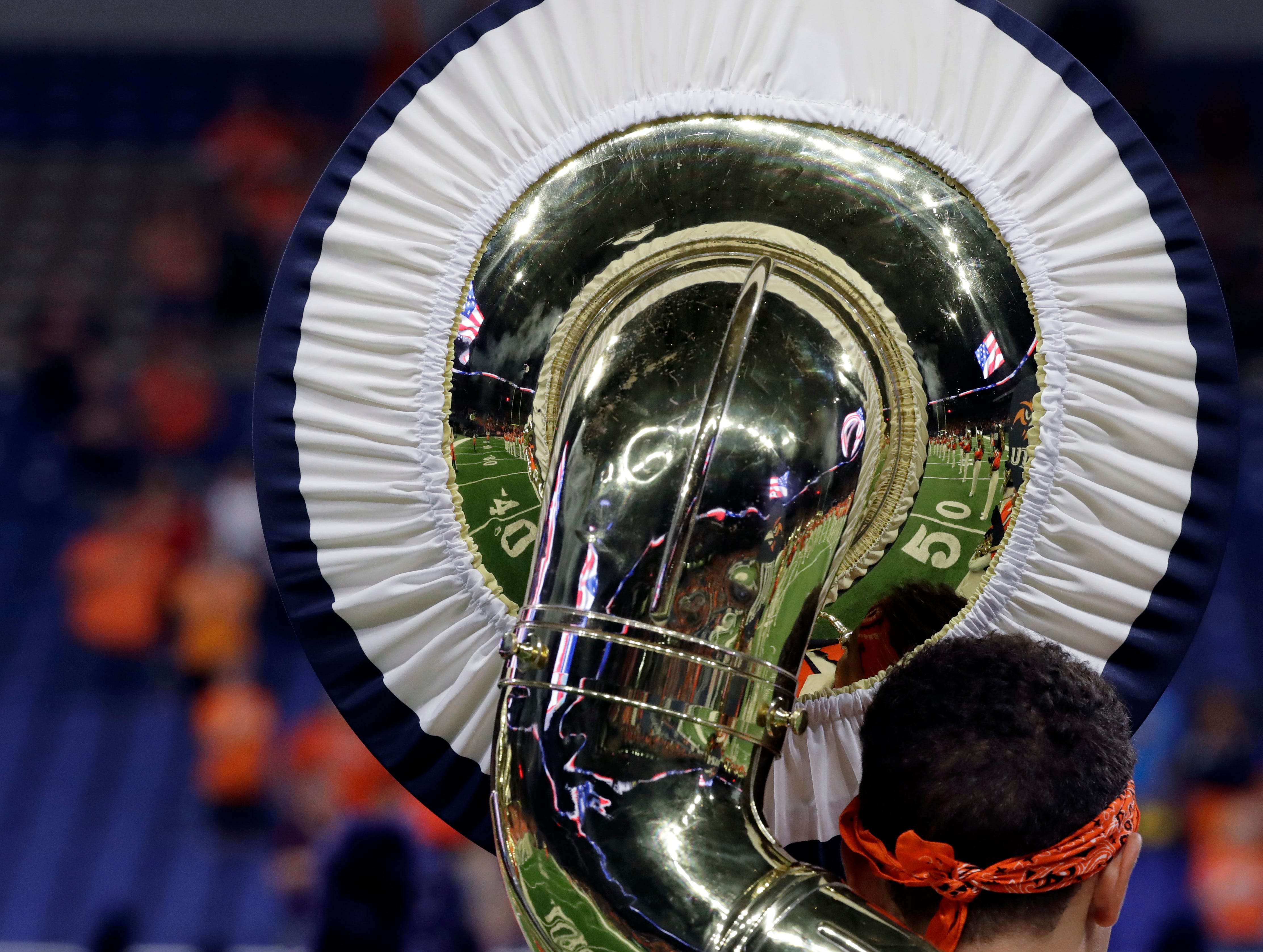 Members of the UTSA band are reflected in a tuba before an NCAA college football game between UTSA and the UTEP, Saturday, Sept. 29, 2018, in San Antonio. (AP Photo/Eric Gay)