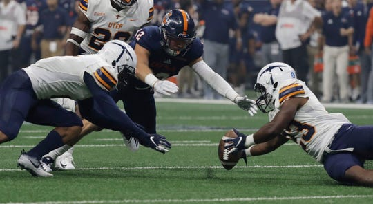 UTEP's Terry Juniel, left, and TK Powell (23) scramble for a fumble with UTSA safety Andrew Martel (12) during the first half of an NCAA college football game Saturday, Sept. 29, 2018, in San Antonio. Martel recovered the fumble. (AP Photo/Eric Gay)