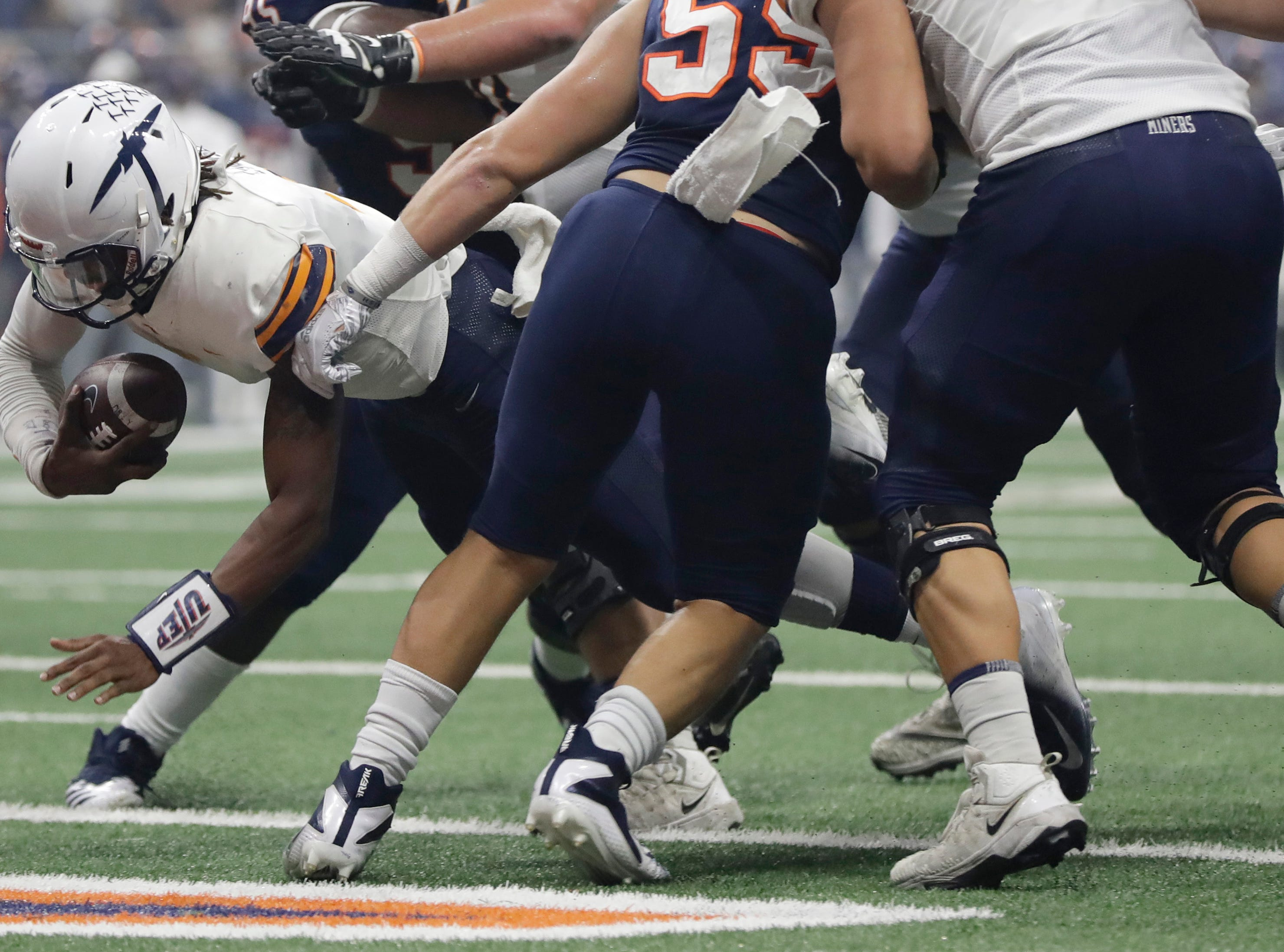 UTEP quarterback Kai Locksley (1) dives for a touchdown against UTSA during the first half of an NCAA college football game Saturday, Sept. 29, 2018, in San Antonio. (AP Photo/Eric Gay)