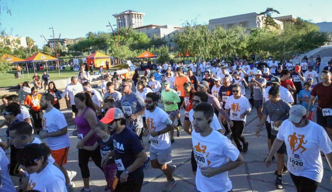Runners and walkers start out on the 9th annual Miner Dash & Family Fiesta Sunday at Centennial Plaza on the UTEP campus. Organizers said 320 people registered for the event, which kicks off a series of events for homecoming week 2018.