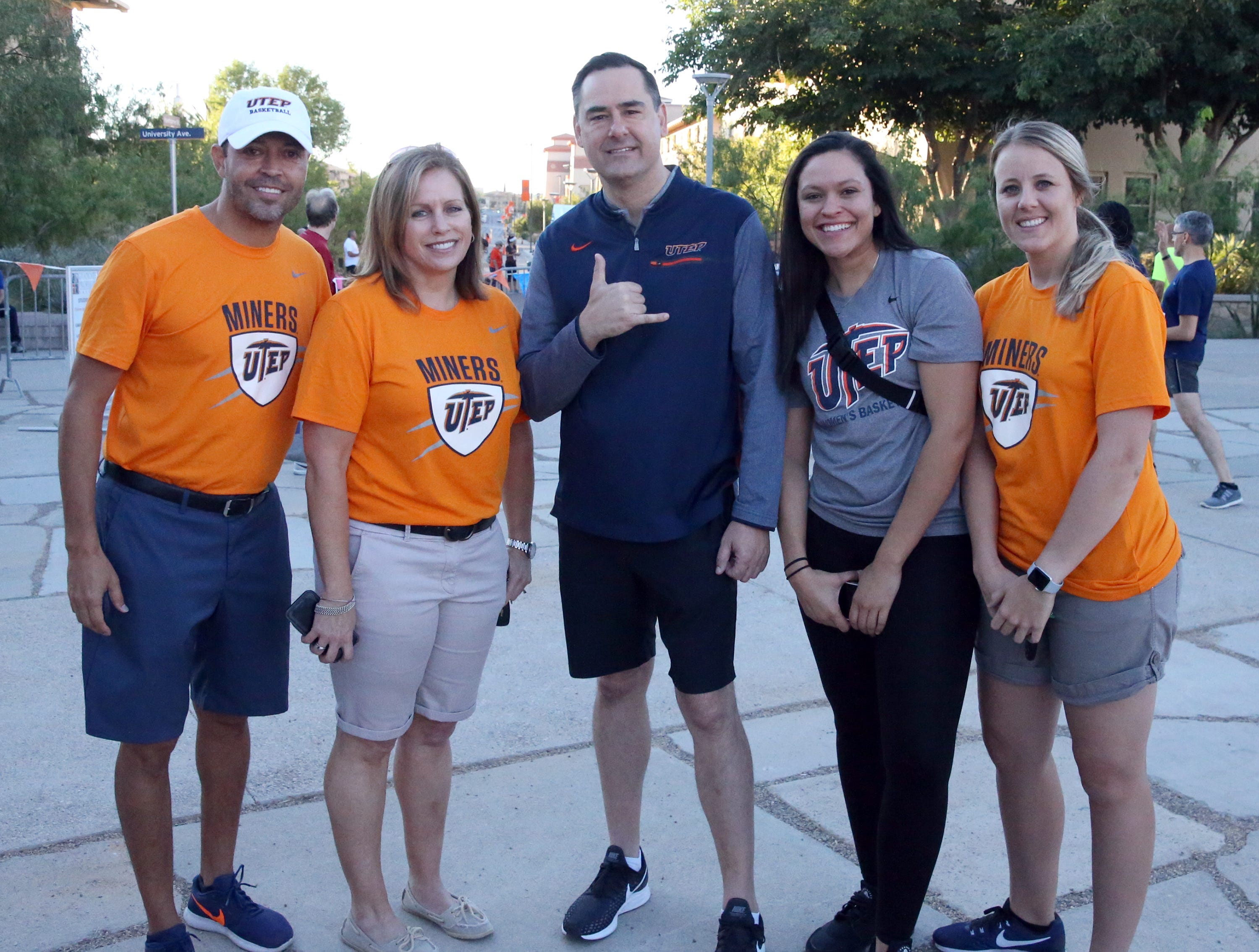 UTEP women's basketball coaches were on hand to lend support at the 9th Miner Dash & Family Fiesta Sunday at Centennial Plaza on the UTEP campus. They are from left: Michael Madrid, Lori Morris, head coach Kevin Baker, Lexi Murphy and Kalya Weaver.