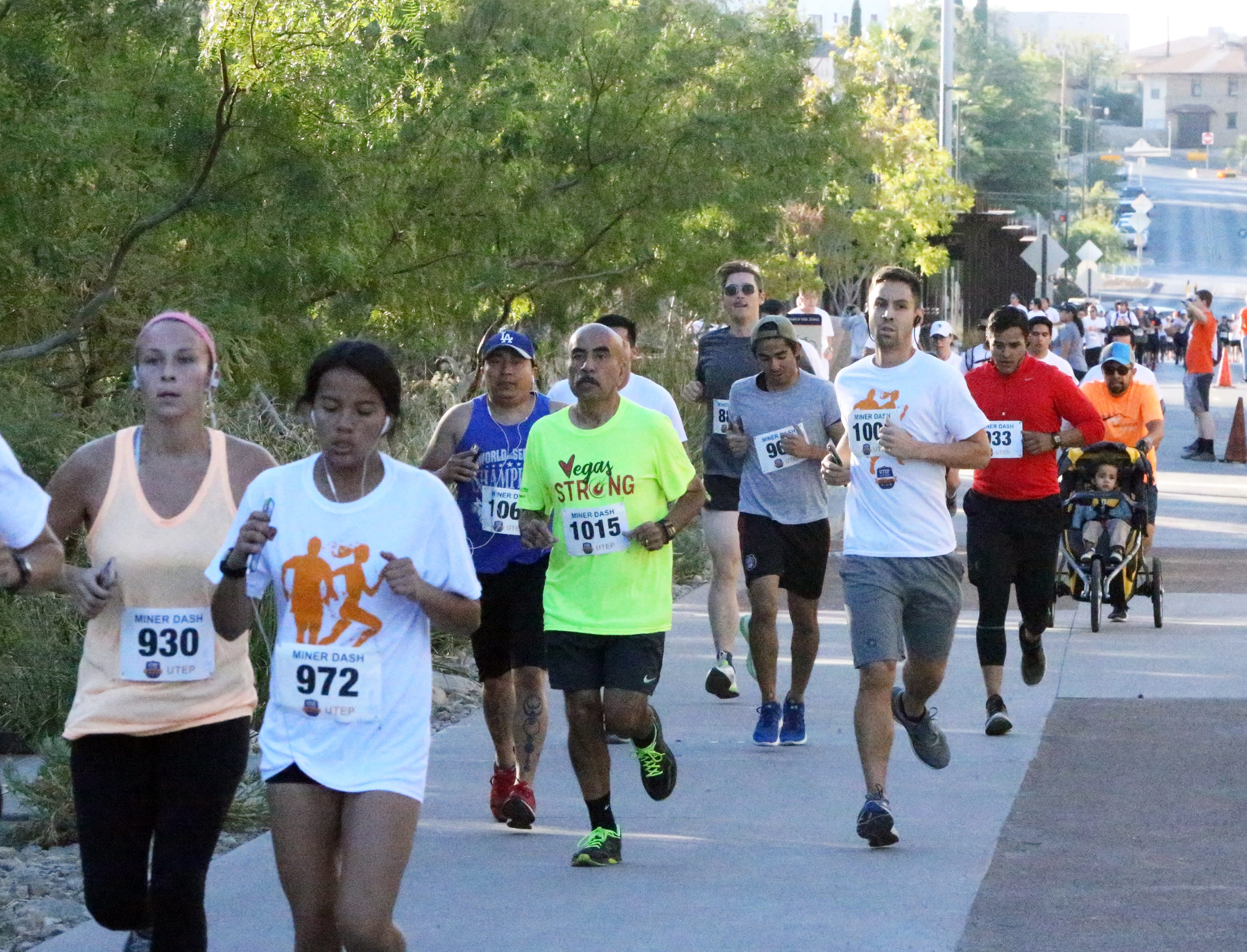 Runners make their way along the UTEP campus Sunday during the Miner Dash and Family Fiesta.