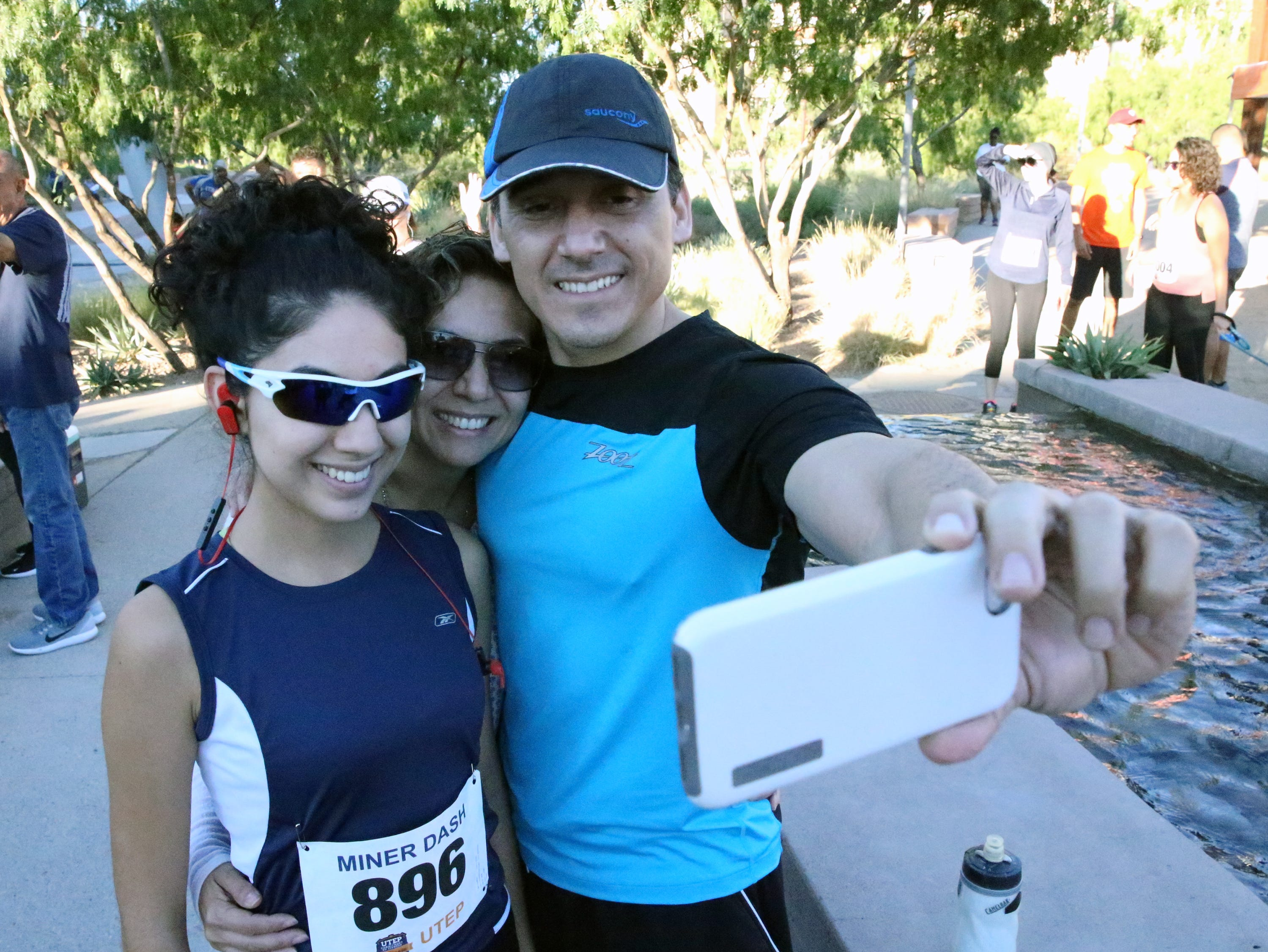 Andrea Pineda, left, with parents Nadia and Enrique Pineda before the race Sunday.