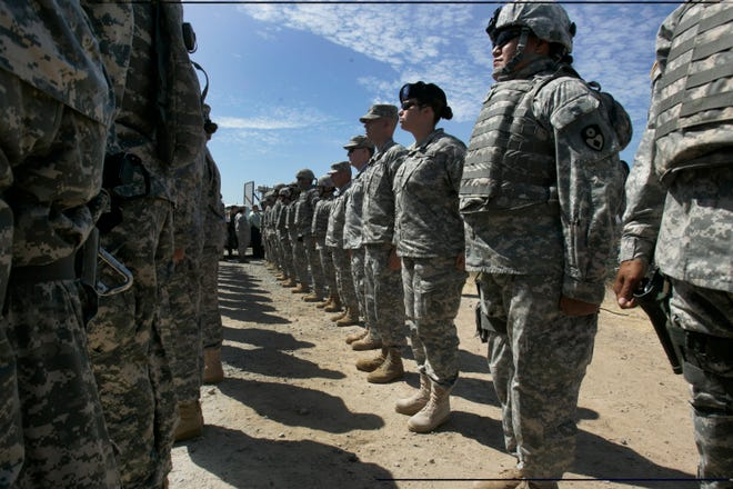 This Aug. 18, 2010, file photo shows California National Guard troops, who are part of Task Force Sierra, deployed at the border along with Border Patrol Agents near the California/Mexico border in San Diego. California Gov. Jerry Brown on Friday extended the state National Guard's participation in President Donald Trump's border deployment by six months.