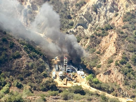 A Ventura County helicopter unit assists with an oil well fire outside Santa Paula.