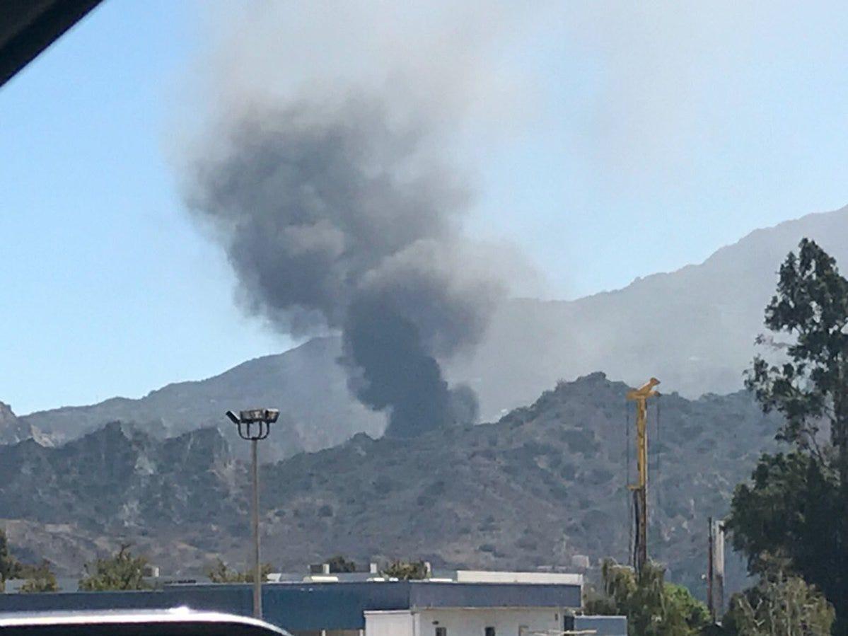 An oil well fire outside Santa Paula Sunday sent a large plume of smoke skyward.