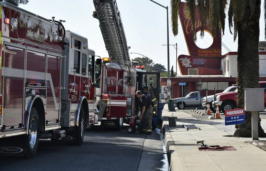 Tulare firefighters pack up after extinguishing a fire in the attic above Ace Guns and Ammo along Tulare Avenue on Saturday, September 29, 2018.